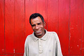 on ones own stock photography | Mauritius, Man and red wall, Poste de Flacq, image id 9-201-56
