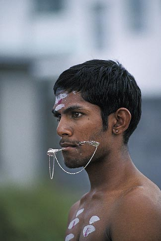 image 9-220-7 Mauritius, Cavadee Festival, A devotee with pierced tongue