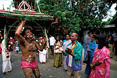 horizontal stock photography | Mauritius, Cavadee Festival, Devotee dancing with wooden cavadee, image id 9-221-39