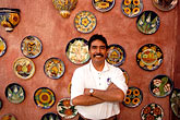 plates stock photography | Mexico, San Jose del Cabo, Shopkeeper, image id 0-42-1