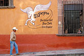 signage stock photography | Mexico, San Miguel de Allende, Man on street outside El Pegaso restaurant, image id 4-263-29