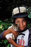head protection stock photography | Mexico, San Miguel de Allende, Young boy with kitten, image id 4-265-8