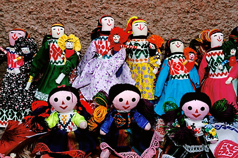 image 4-283-8 Mexico, San Miguel de Allende, Dolls for sale by street vendor