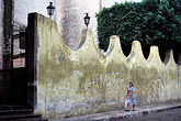 woman walking stock photography | Mexico, San Miguel de Allende, Wall outside Bellas Artes, image id 4-290-30