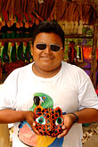 sunglasses stock photography | Mexico, Riviera Maya, Artisan with jaguar mask, image id 4-850-2827
