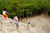 people stock photography | Mexico, Yucatan, Coba, climbing El Castillo, image id 4-850-2860
