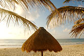 sunset on beach stock photography | Mexico, Riviera Maya, Tulum, Palapa on the beach, image id 4-850-2956