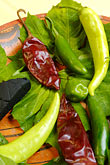 vertical stock photography | Mexican Food, Typical ingredients for Mayan Cuisine, Chaya leaves, achiote, habaneros, image id 4-850-3755