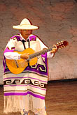 upright stock photography | Mexico, Riviera Maya, Xcaret, guitar player, image id 4-850-3903