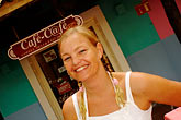 horizontal stock photography | Mexico, Riviera Maya, Puerto Aventuras, Mimi Lund of Internet Cafe, image id 4-850-4574
