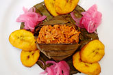 native stock photography | Mexican Food, Cochinita Pibil, banana leaf wrapped pork cooked barbacoa style, image id 4-850-5149