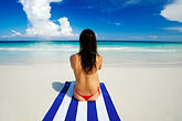 quiet stock photography | Mexico, Riviera Maya, Xpu Ha Beach, woman sunbathing, image id 4-882-11