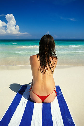 image 4-882-4 Mexico, Riviera Maya, Xpu Ha Beach, woman sunbathing