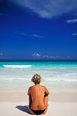 woman seated outside stock photography | Mexico, Riviera Maya, Xpu Ha Beach, woman sunbathing, image id 4-882-57