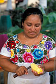 mexico stock photography | Mexico, Playa del Carmen, Woman at fruit stand, image id 4-883-52