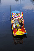one man only stock photography | Mexico, Xochimilco, Sailing the canals in a trajinera., image id 5-11-30
