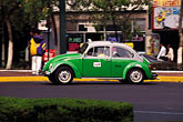 city stock photography | Mexico, Mexico City, Volkswagen taxi, Paseo de la Reforma, image id 5-35-20