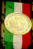 city stock photography | Mexico, Mexico City, Mexican Flag and seal, Z�calo, image id 5-67-21