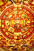 classic stock photography | Mexican art, Painting of design on Piedra del Sol, Aztec calendar, 1350-1531, Museo de Anthropologia , image id 5-80-33