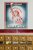 vertical stock photography | Americana, Post Office boxes and Liberty stamp, image id 4-940-1075