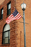 us flag stock photography | Michigan, Upper Peninsula, Munising, Flag, image id 4-940-912