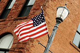 horizontal stock photography | Michigan, Upper Peninsula, Flag on Lamppost, image id 4-940-914