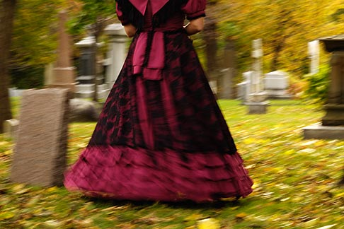 image 6-460-7500 Canada, Montreal, Mount Royal Cemetery, woman with period dress, walking, low angle view