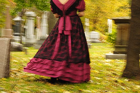 image 6-460-7501 Canada, Montreal, Mount Royal Cemetery, woman with period dress, walking, low angle view