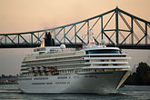 span stock photography | Canada, Montreal, Cruise ship in St. Lawrence River, with Pont Jacques-Cartier, image id 6-460-7833