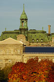 sunlight stock photography | Canada, Montreal, Hotel de Ville with fall foliage, image id 6-460-7869