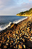 golden light stock photography | Montserrat, Woodlands Beach, rocky pebbles, image id 0-157-12