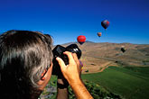 one man only stock photography | Nevada, Reno, Photographing from a hot air  balloon, image id 0-326-89