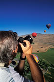 one man only stock photography | Nevada, Reno, Photographing from a hot air  balloon, image id 0-326-91
