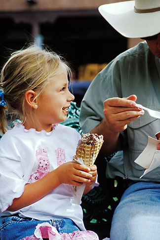 image S4-351-16 New Mexico, Santa Fe, Young girl eating Ice Cream