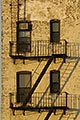 vertical stock photography | New York, New York, Apartment building, fire escape, image id 5-848-0669