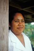 vertical stock photography | Niue, Niuean woman, Avatele Village, image id 9-502-46