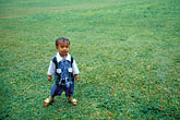 grass stock photography | Niue, Young boy in the rain, Avatele, image id 9-503-84