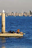 waterfront stock photography | California, Oakland, Couple on dock, Jack London Square, image id 3-278-2