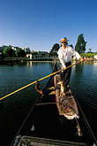 person stock photography | California, Oakland, Lake Merritt, Gondola Servizio, image id 4-729-36