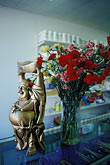 flower stock photography | California, Oakland, Fruitvale, Buddha in shop, image id 9-441-34