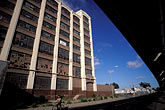 poverty stock photography | California, Oakland, Fruitvale, Montgomery Wards building & BART track, image id 9-441-93
