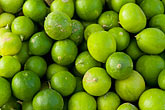 macro stock photography | Oman, Green limes for sale in market, image id 8-730-1814
