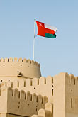 fortification stock photography | Oman, Buraimi, Al Khandaq Fort, and Omani flag, image id 8-730-1842