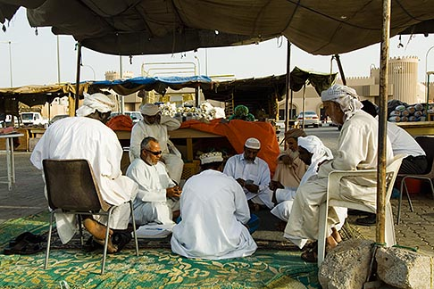 image 8-730-9820 Oman, Buraimi, Omani men playing cards in marketplace