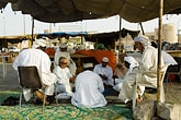 asia stock photography | Oman, Buraimi, Omani men playing cards in marketplace, image id 8-730-9820