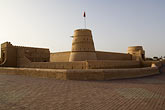 al khandaq fort stock photography | Oman, Buraimi, Al Khandaq Fort, and Omani flag, image id 8-730-9823