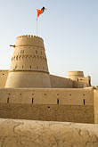 fort stock photography | Oman, Buraimi, Al Khandaq Fort, and Omani flag, image id 8-730-9829