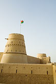 al khandaq fort stock photography | Oman, Buraimi, Al Khandaq Fort, and Omani flag, image id 8-730-9830