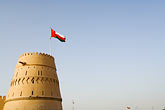 fort stock photography | Oman, Buraimi, Al Khandaq Fort, and Omani flag, image id 8-730-9832
