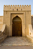 decorated door stock photography | Oman, Buraimi, Al Khandaq Fort, Entrance gate, image id 8-730-9837